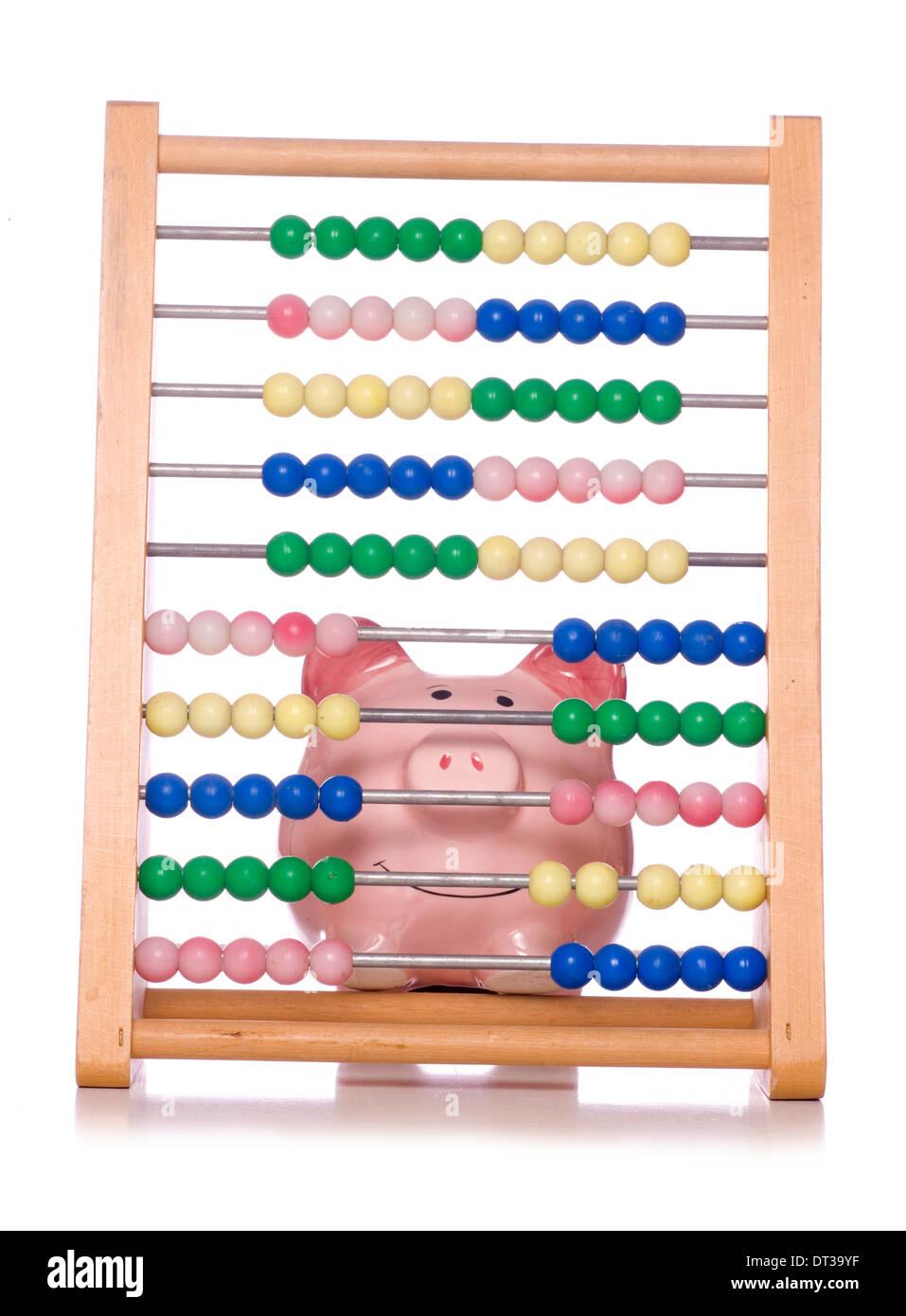 calculating finances piggy bank cutout - Stock Image