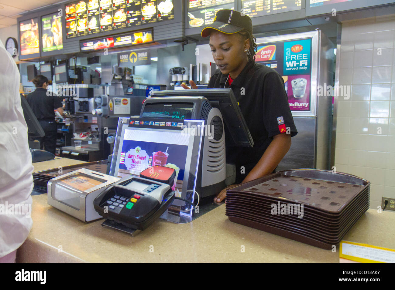 Florida Fort Pierce SR70 McDonald restaurant business fast food hamburger chain counter Black girl teen worker cashier job unif - Stock Image