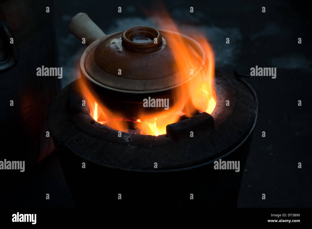Pot simmering on a small barbeque, Yangon, Myanmar - Stock Image