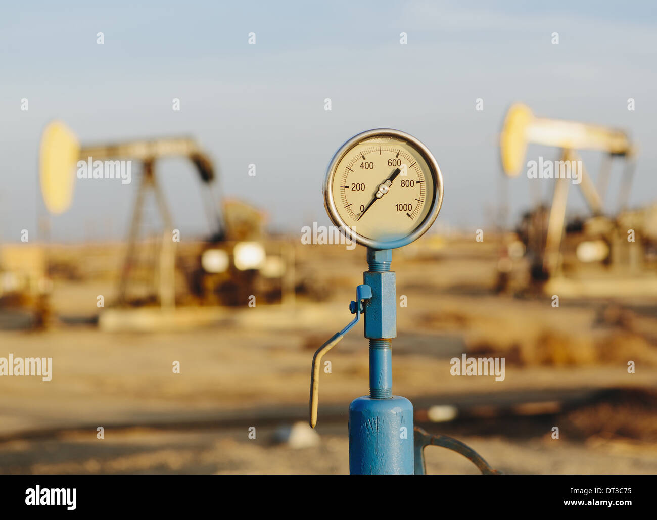Air pressure gauge, oil rigs in background, Sunset-Midway oil fields, the largest in California. - Stock Image