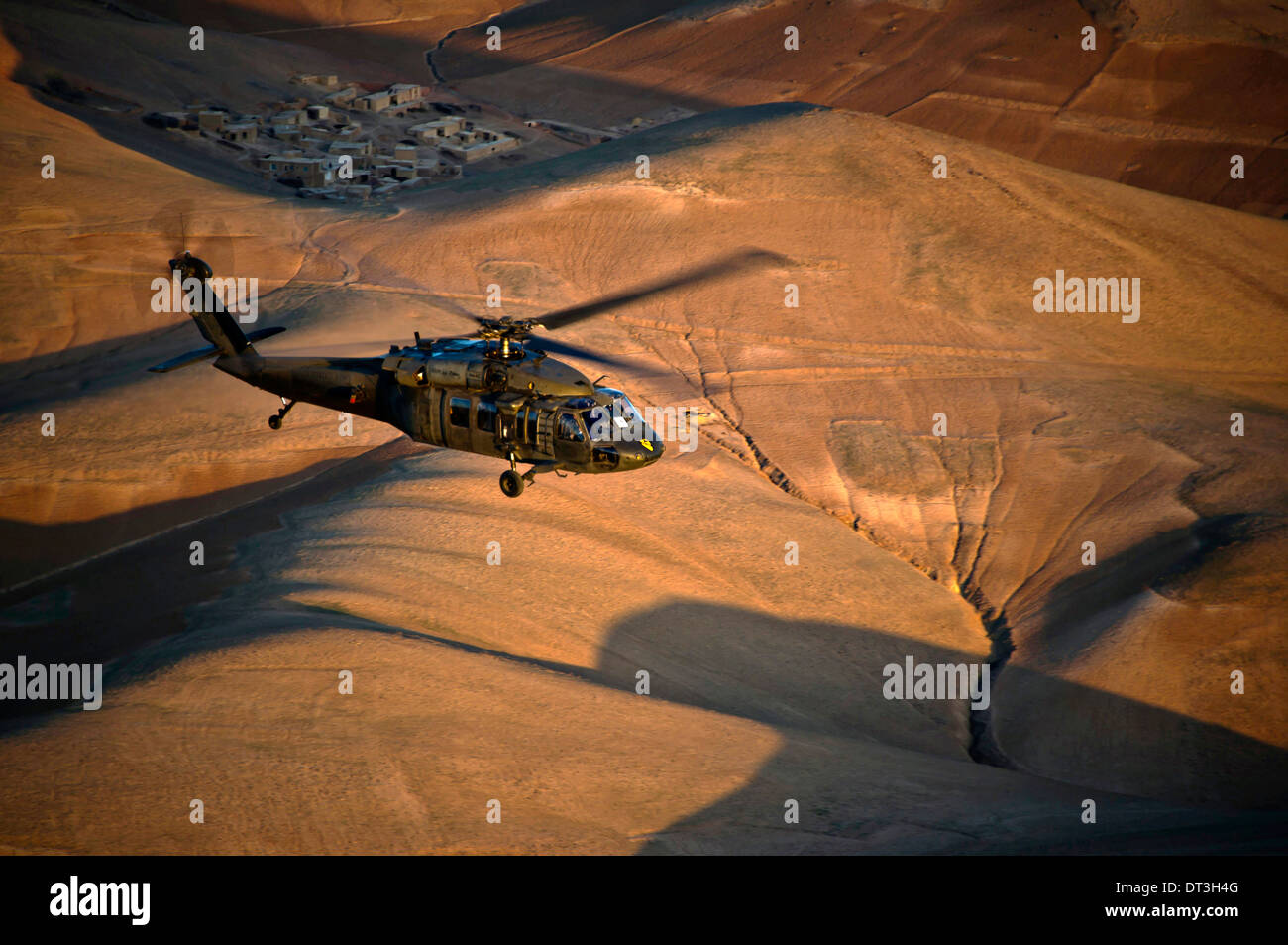 A US Army UH-60 Black Hawk helicopter flies over western Afghanistan April 12, 2012 on the way to FOB Shindand, Herat province, Afghanistan. - Stock Image