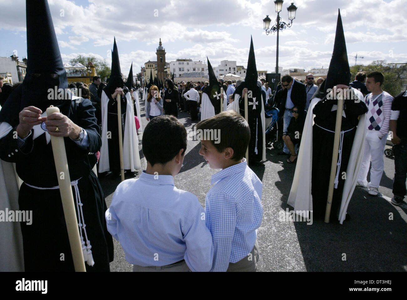 Penitents take part in the El Cachorro brotherhood procession during the Holy Week in Sevilla - Stock Image