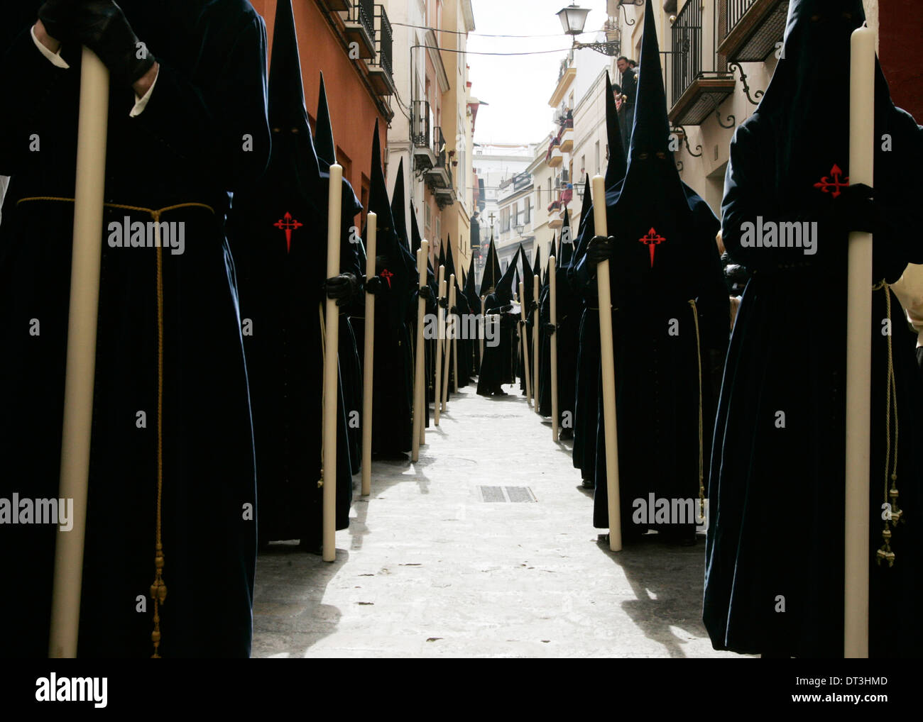 Penitents take part in the La Carretera brotherhood procession during the Holy Week in Sevilla - Stock Image