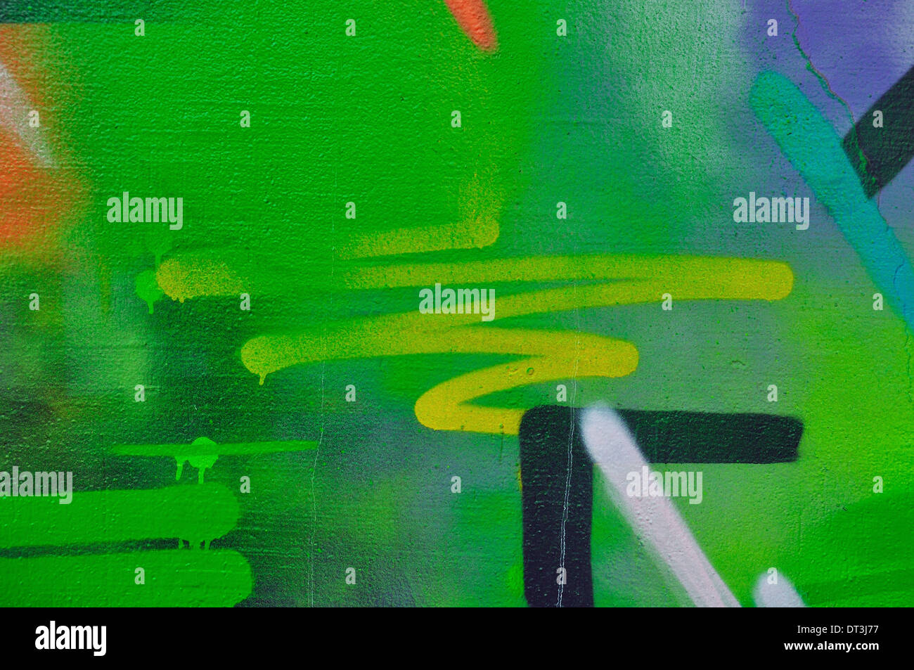 Paint stained wall abstract smudged overlapping graffiti background texture. - Stock Image