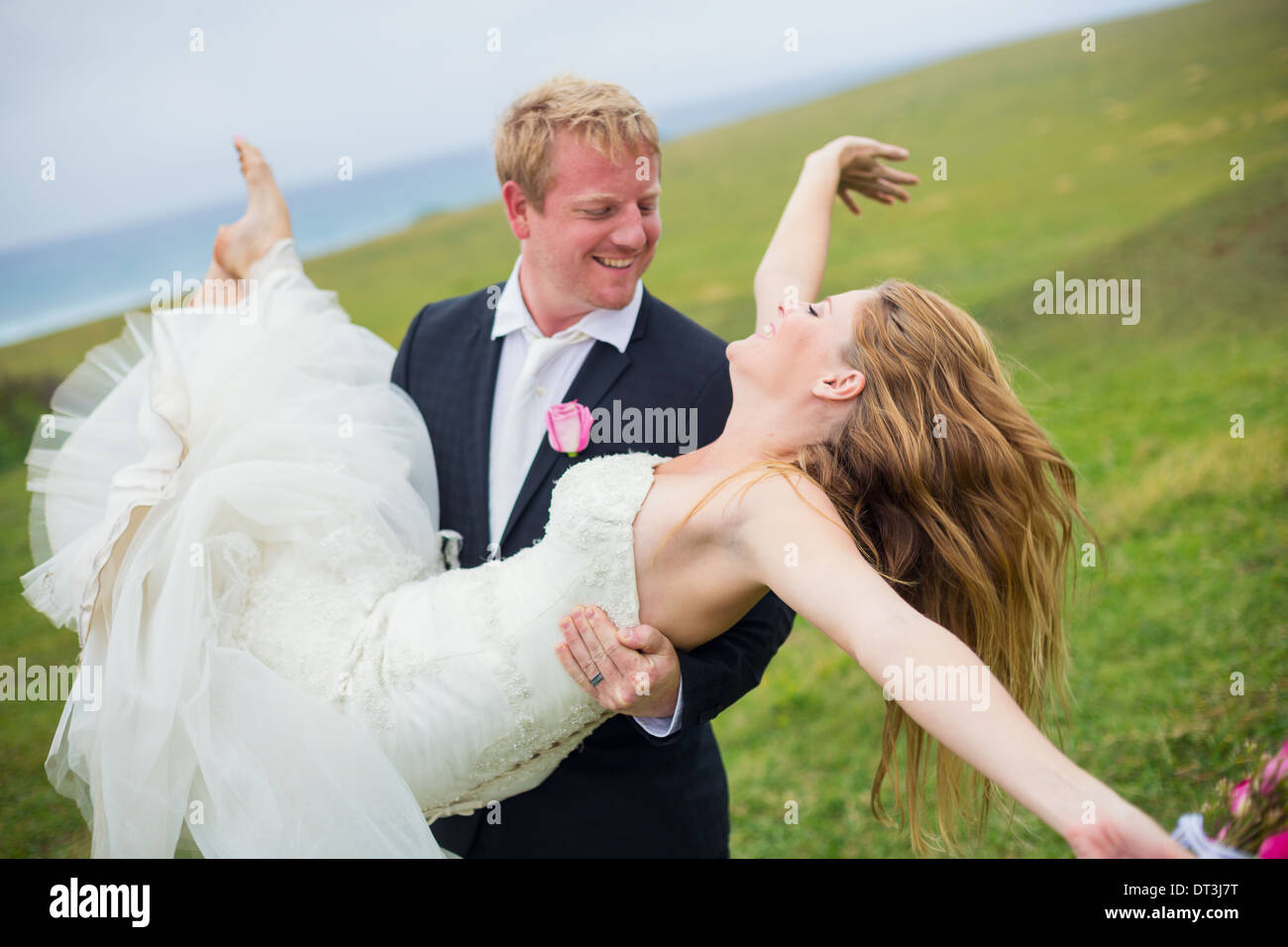Wedding Couple, Happy Bride and Groom, Shallow depth of field, focus on bride - Stock Image