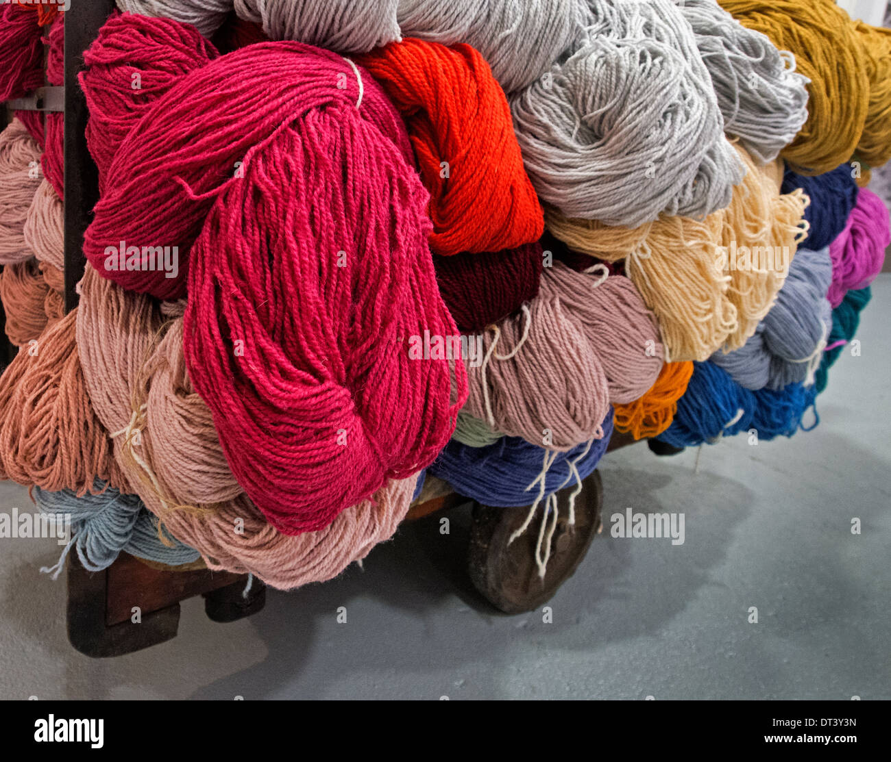 a trolley carries skeins of different coloured yarns for carpet-making, in the Kidderminster Museum of Carpet - Stock Image