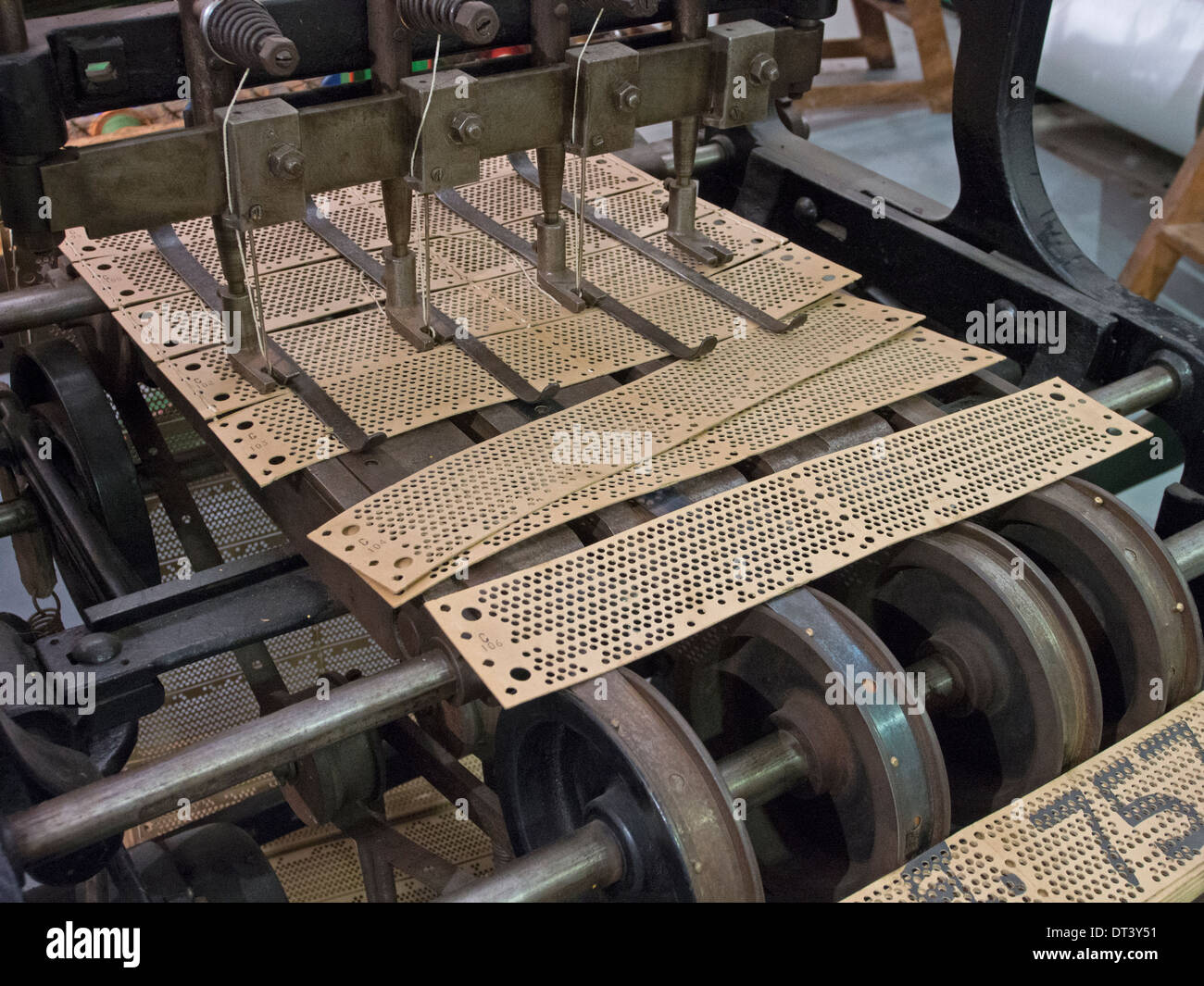 A machine for stitching together the Jacquard cards which control the pattern being woven by an automated loom. Stock Photo