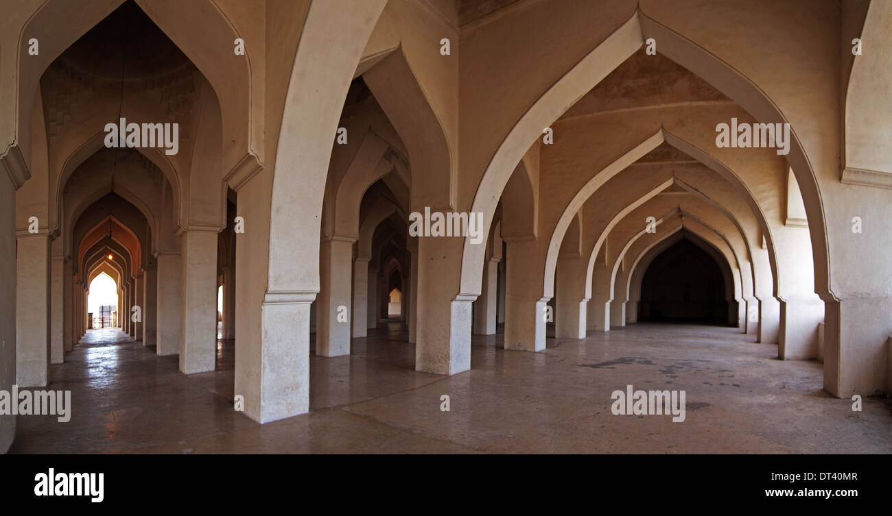 The austere arcaded interior of the Jami Masjid in Gulbarga, seen in panoramic view. - Stock Image
