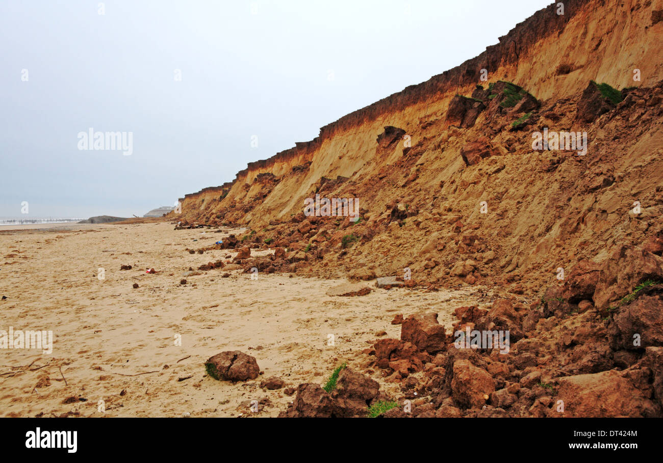Erosion of cliffs following tidal surge at Happisburgh, Norfolk, England, United Kingdom. - Stock Image