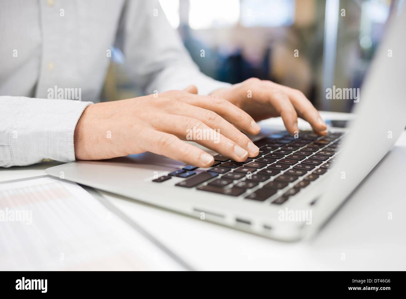 Male computer hands fingers desk - Stock Image
