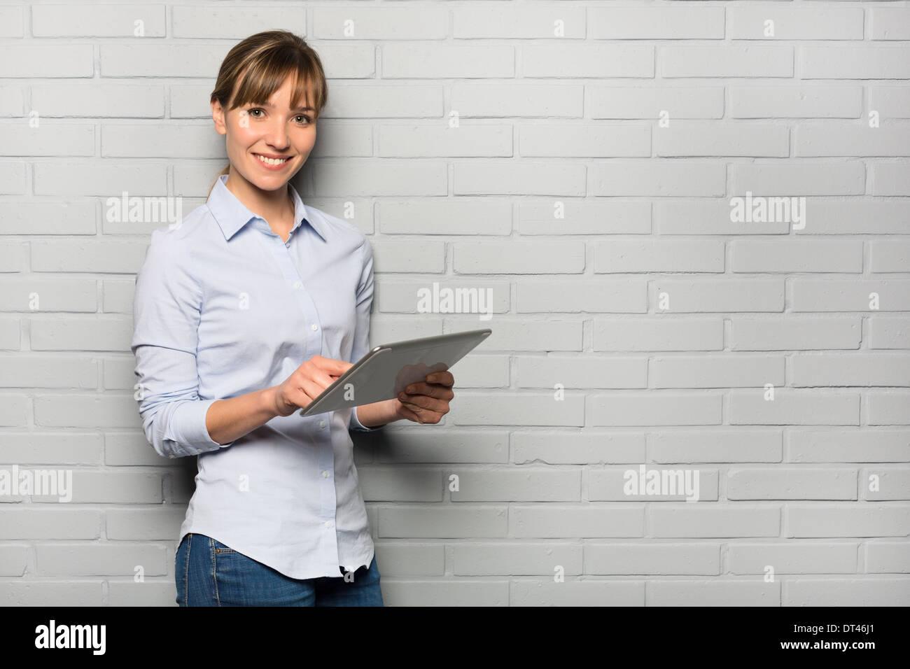 Female cute smiling computer digital studio looking camera - Stock Image