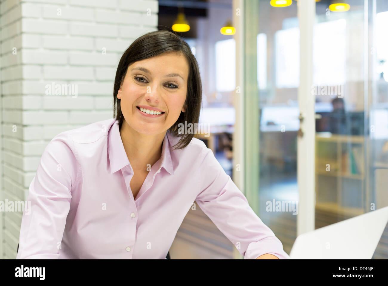 Portrait Female young business happy computer desk - Stock Image