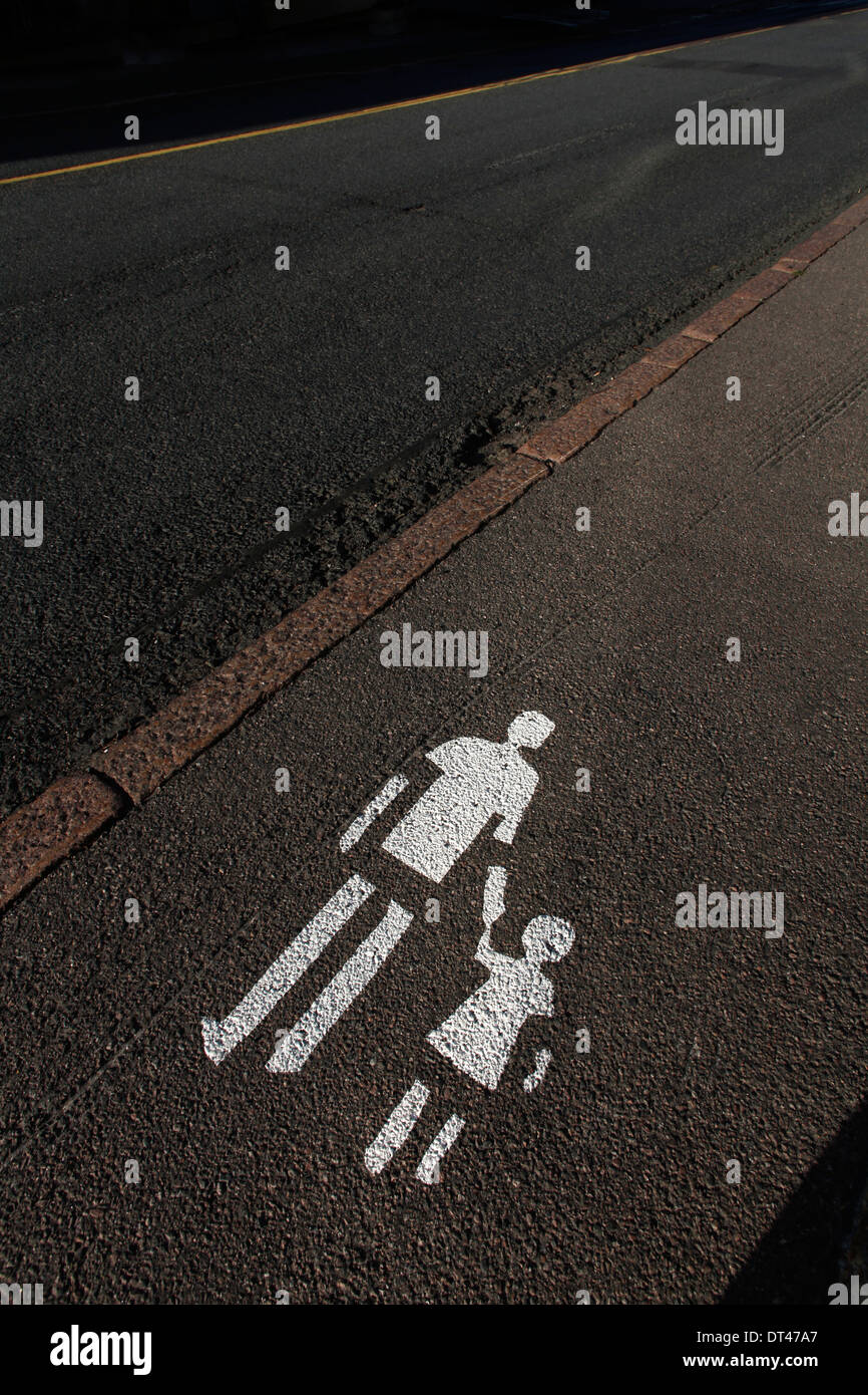 Pedestrians sign painted on the sidewalk - Stock Image