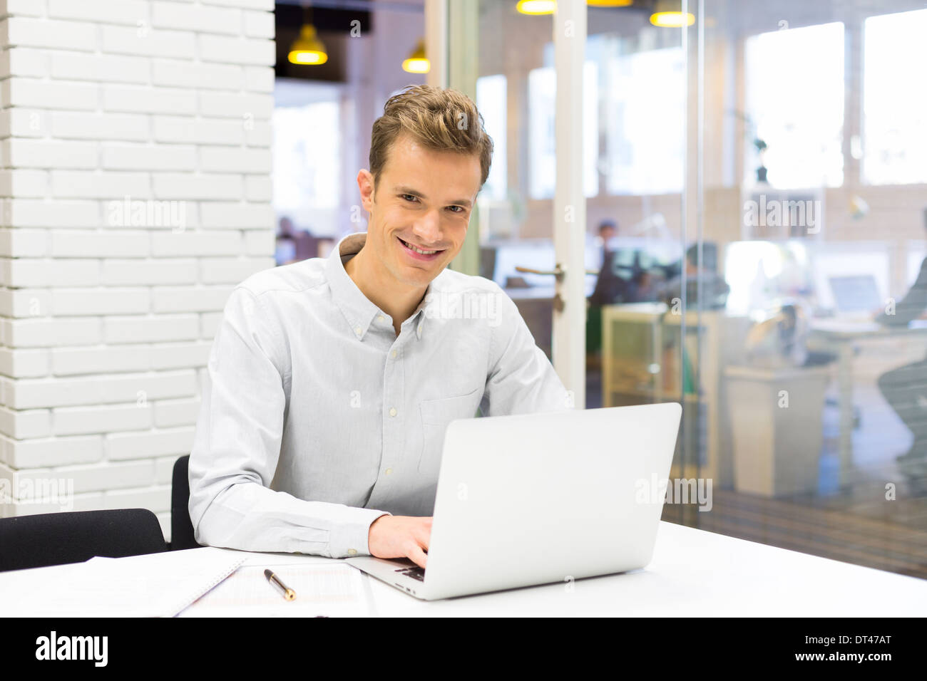 Male business computer desk looking camera Stock Photo