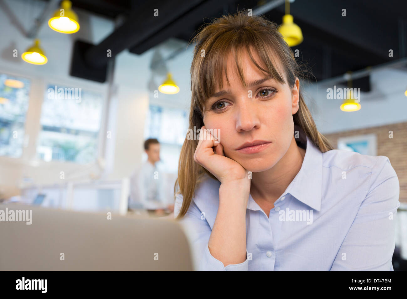 Female business tired desk computer - Stock Image