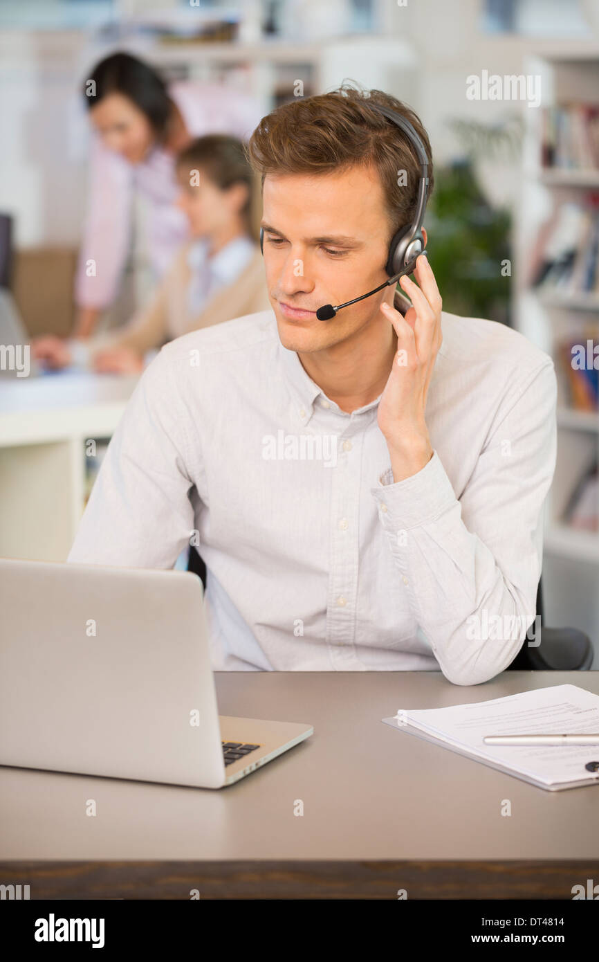 Male calling computer desk video conference - Stock Image