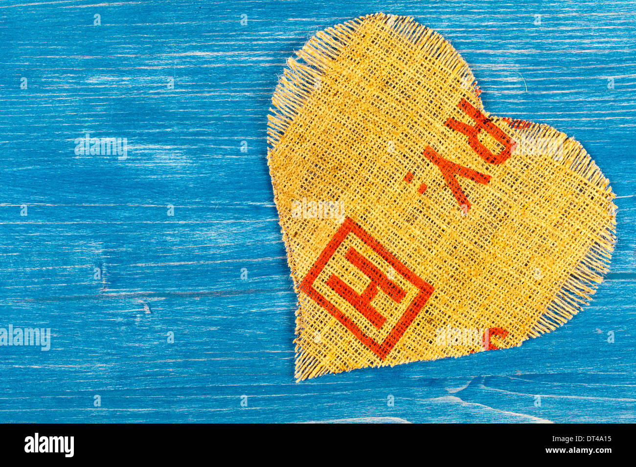 Heart made of linen on a blue background - Stock Image