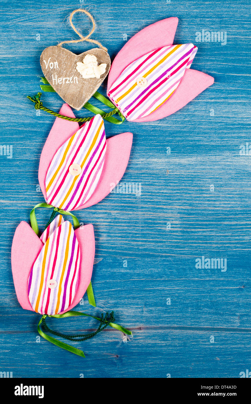 Wooden heart with 3 tulips Fabric - Stock Image