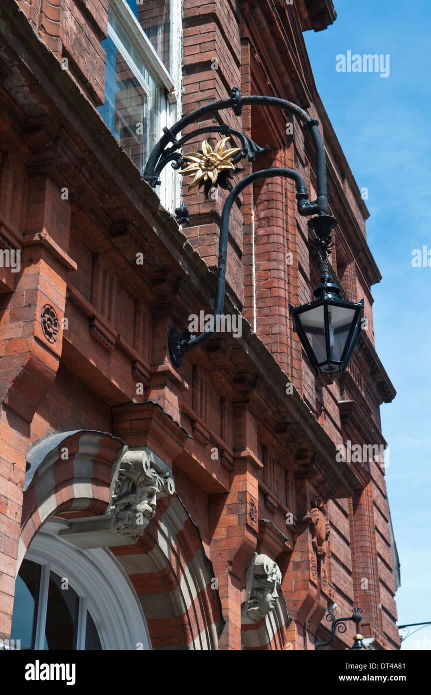 Ornate iron lamp over the entrance door to Lewes Town Hall in East Sussex, England - Stock Image