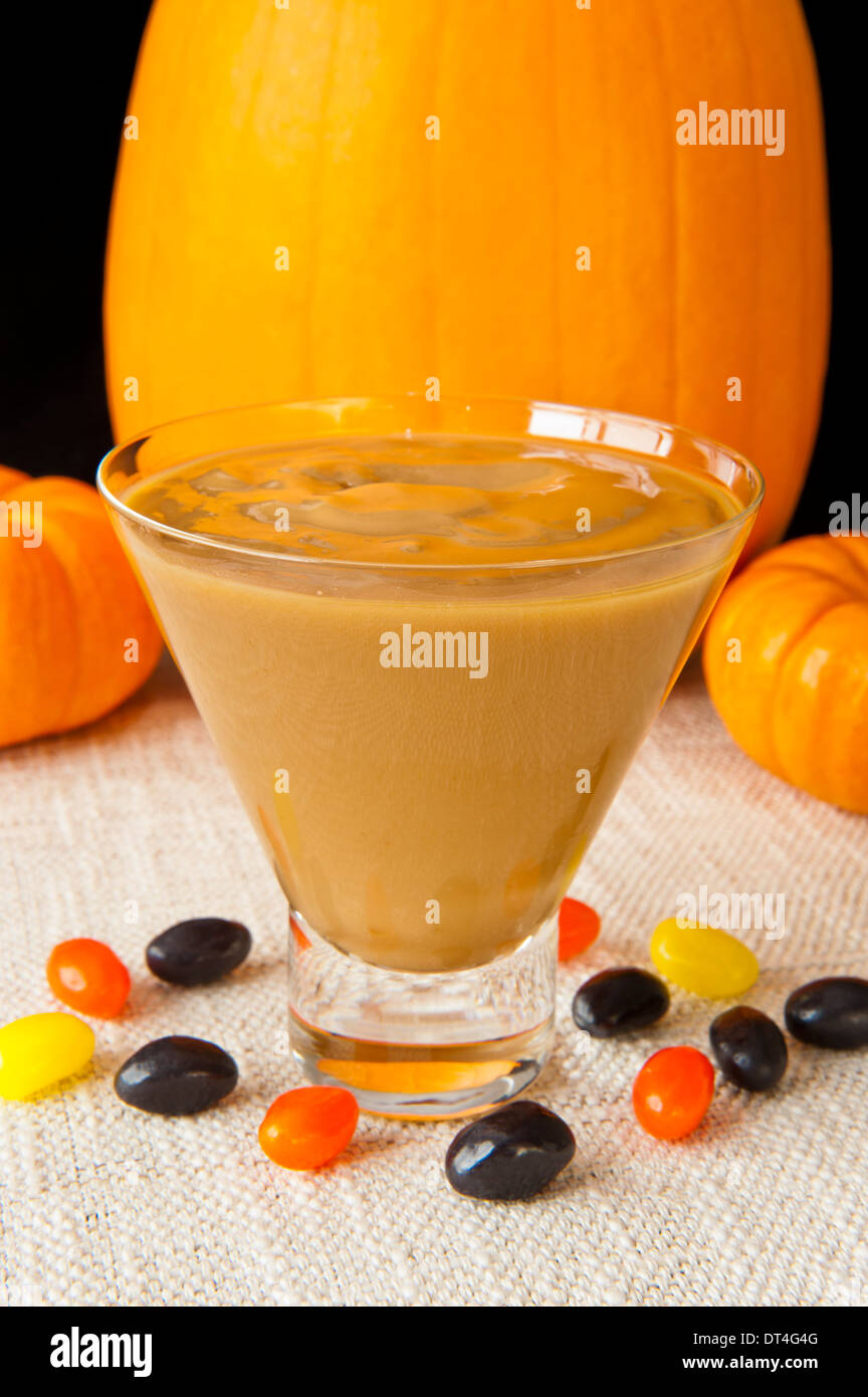 Dish of Butterscotch pudding with jellybeans and pumpkins - Stock Image