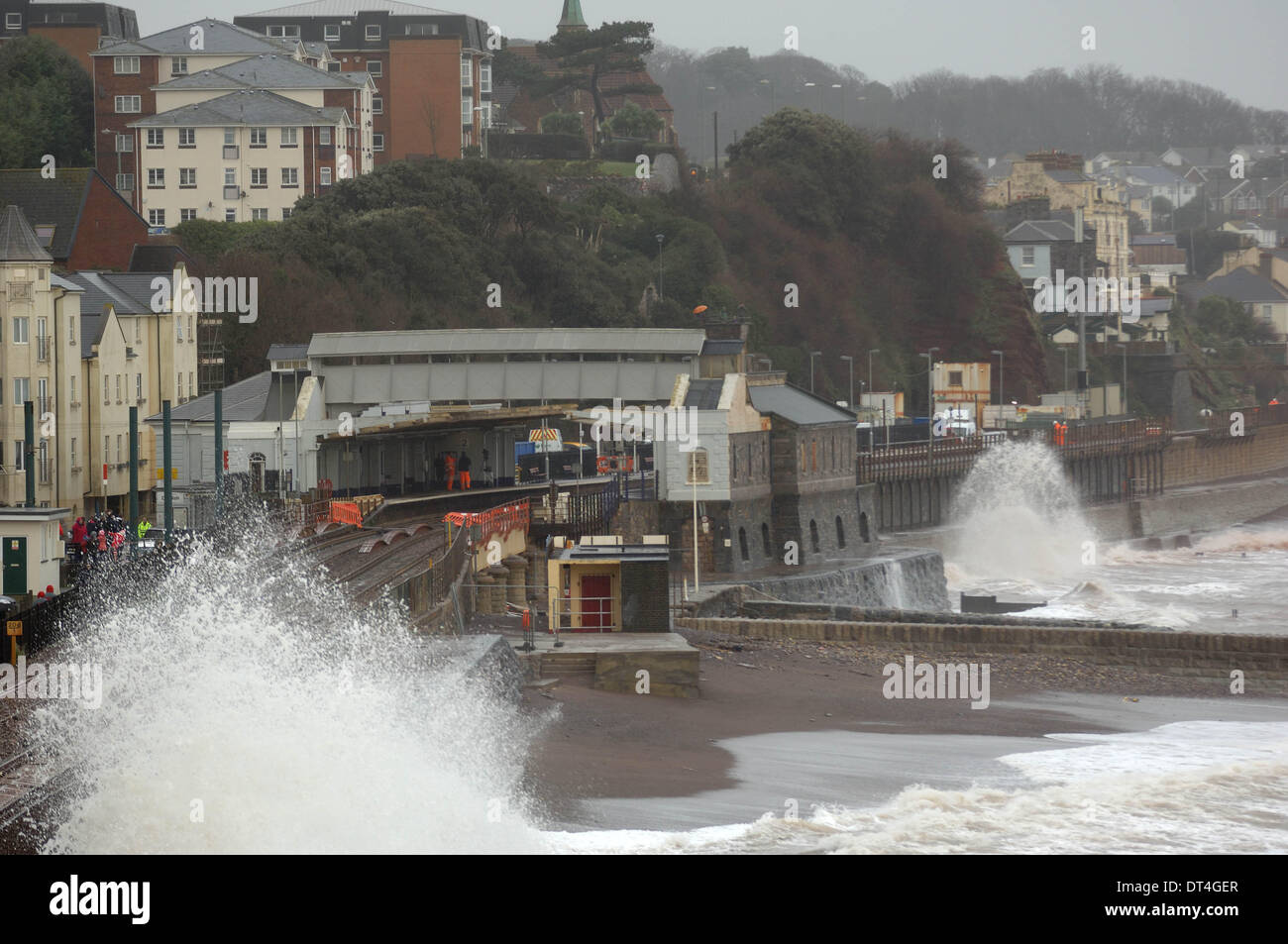 Dawlish, UK. 8th Feb, 2014. The damaged railway station at Dawlish in Devon England continues to be battered by storms. The rail line to Cornwall is washed away just outside the station.  Credit Paul Glendell - Stock Image