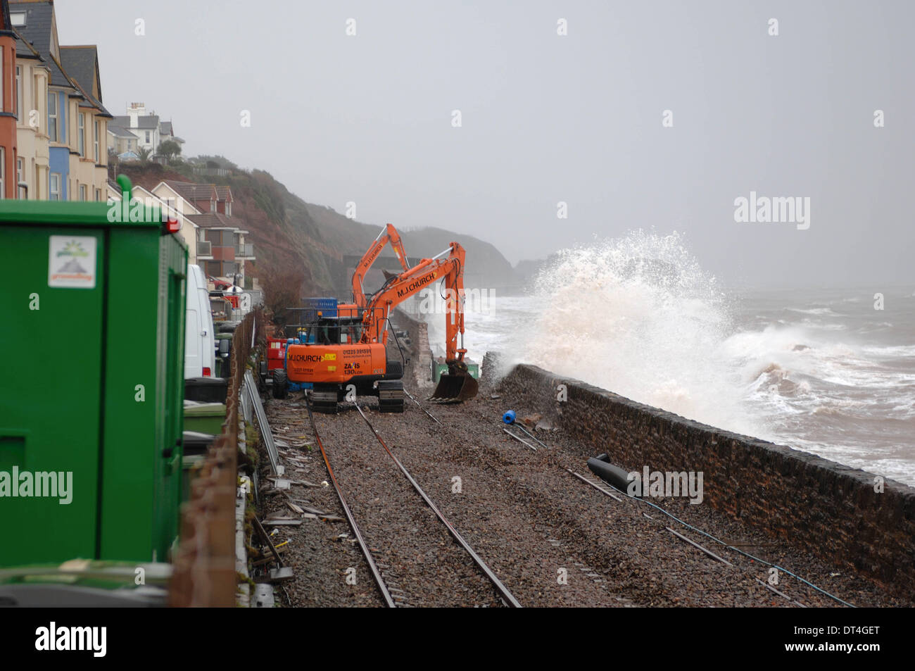 Dawlish, UK. 8th Feb, 2014. Work begins to restore the severed rail line at Dawlish in Devon England cutting all rail links to Cornwall after storms wash away the sea wall. Credit Paul Glendell 5 Feb 2014 - Stock Image