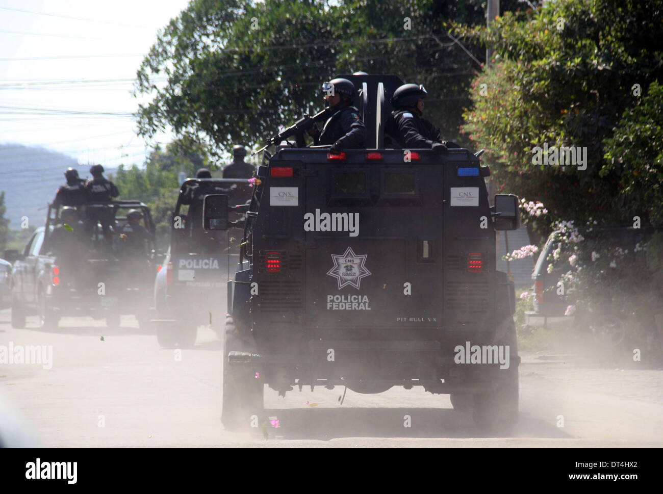 Michoacan, Mexico. 8th Feb, 2014. Federal Police officers enter the municipality of Apatzingan, in Michoacan, Mexico, on Feb. 8, 2014. Members of self-defense groups entered Apatzingan on Saturday accompanied by the Mexican Army and Federal Police to take control of the town that has been affected by the actions of the criminal organization 'Los Caballeros Templarios', according to the local press. © Armando Solis/Xinhua/Alamy Live News - Stock Image