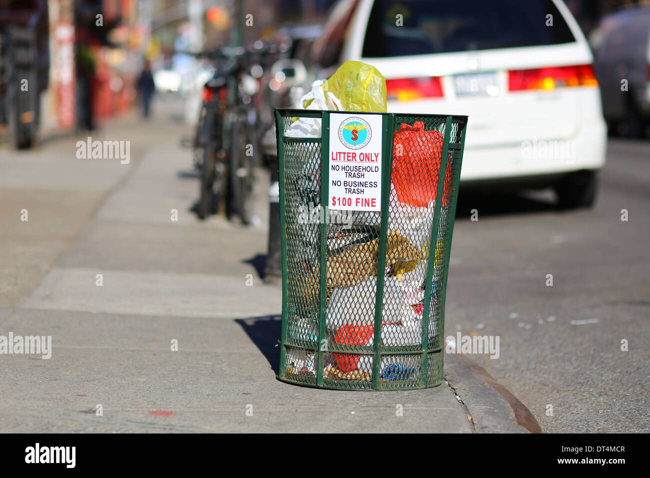 A NYC Garbage Can - Stock Image