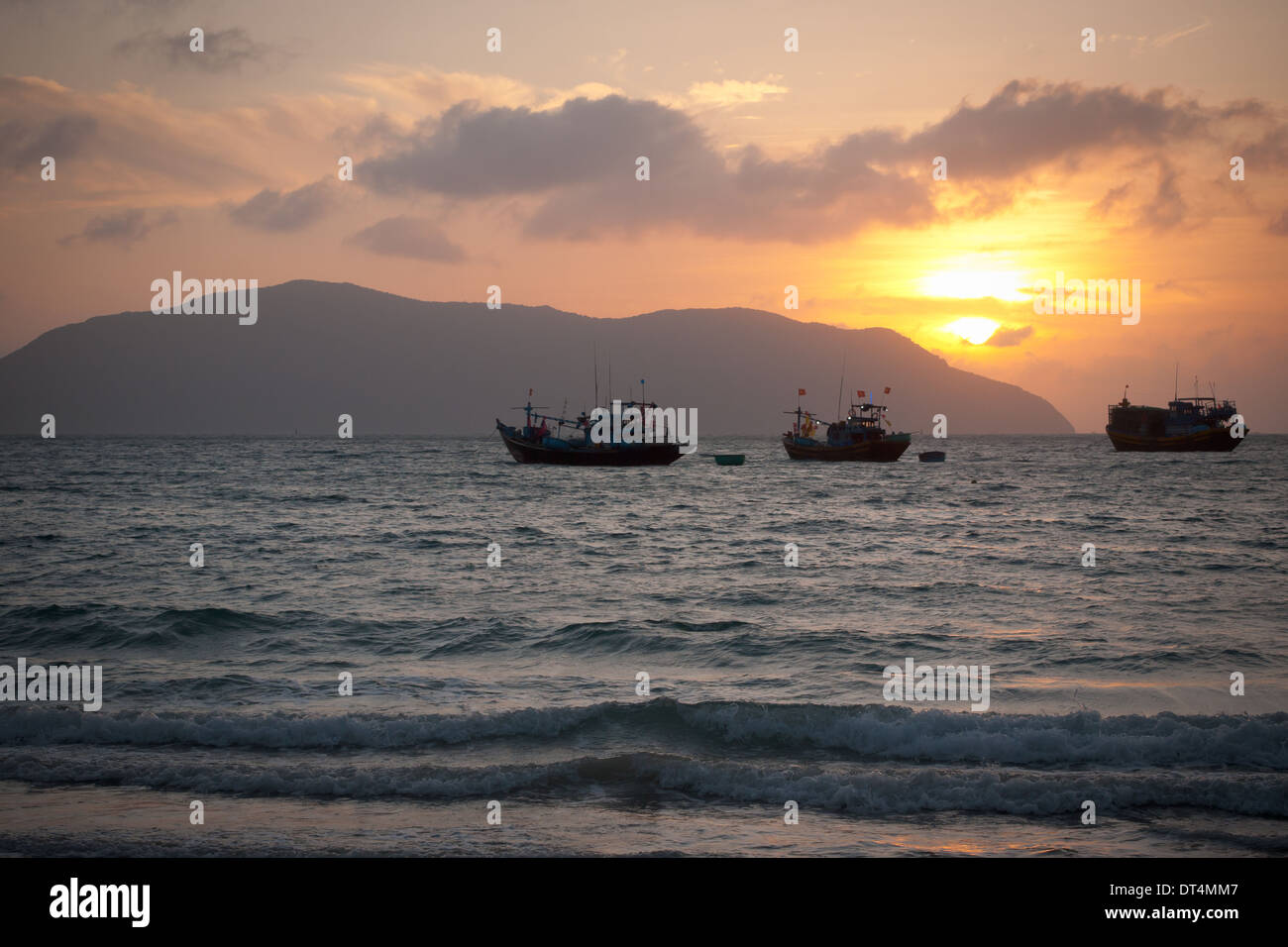 Sunrise over the Con Dao Islands, Vietnam, as seen from Con Son Island.  Bay Canh Island is in the distance. - Stock Image