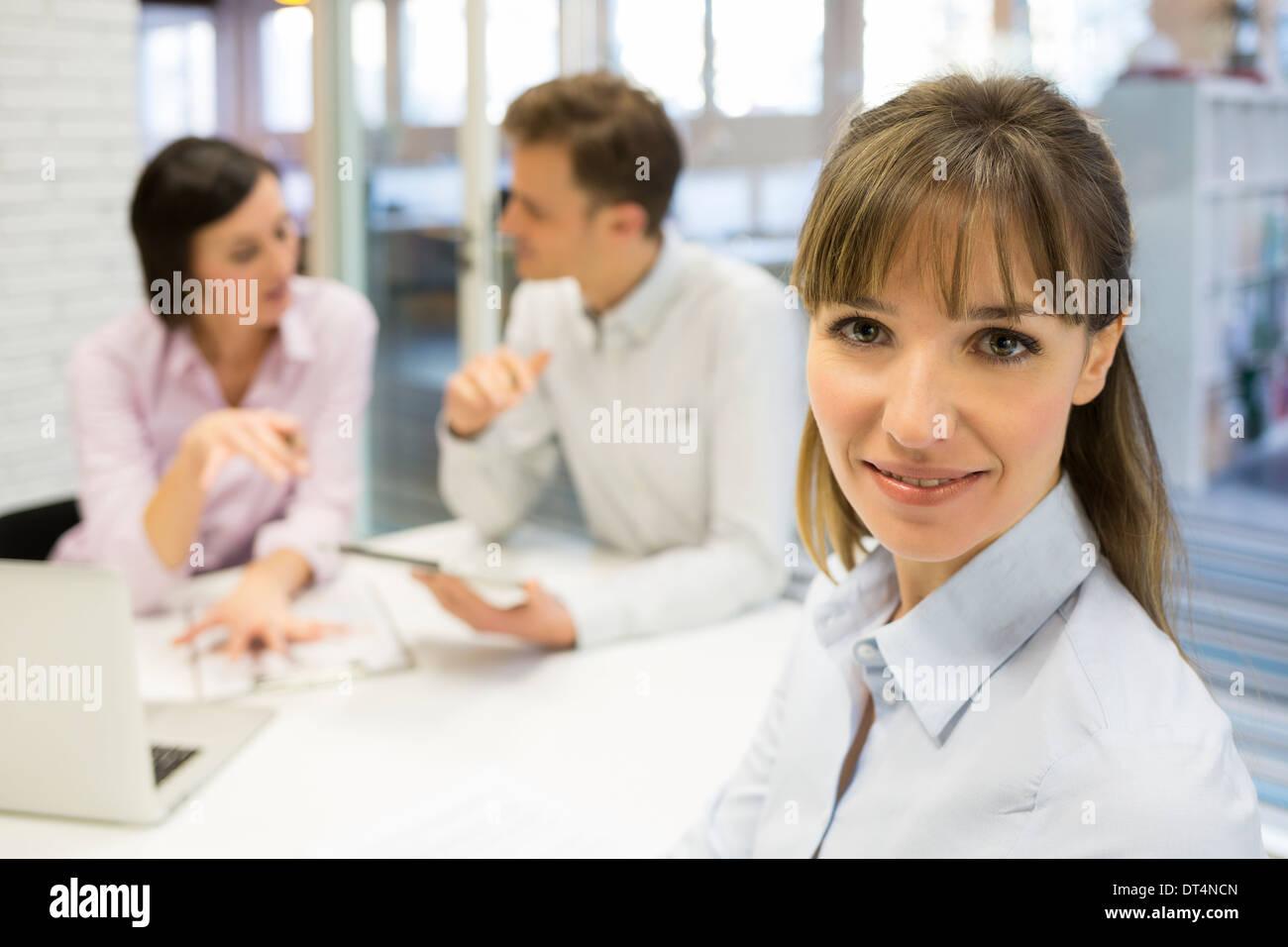 Business woman reunion office desk colleagues smil - Stock Image