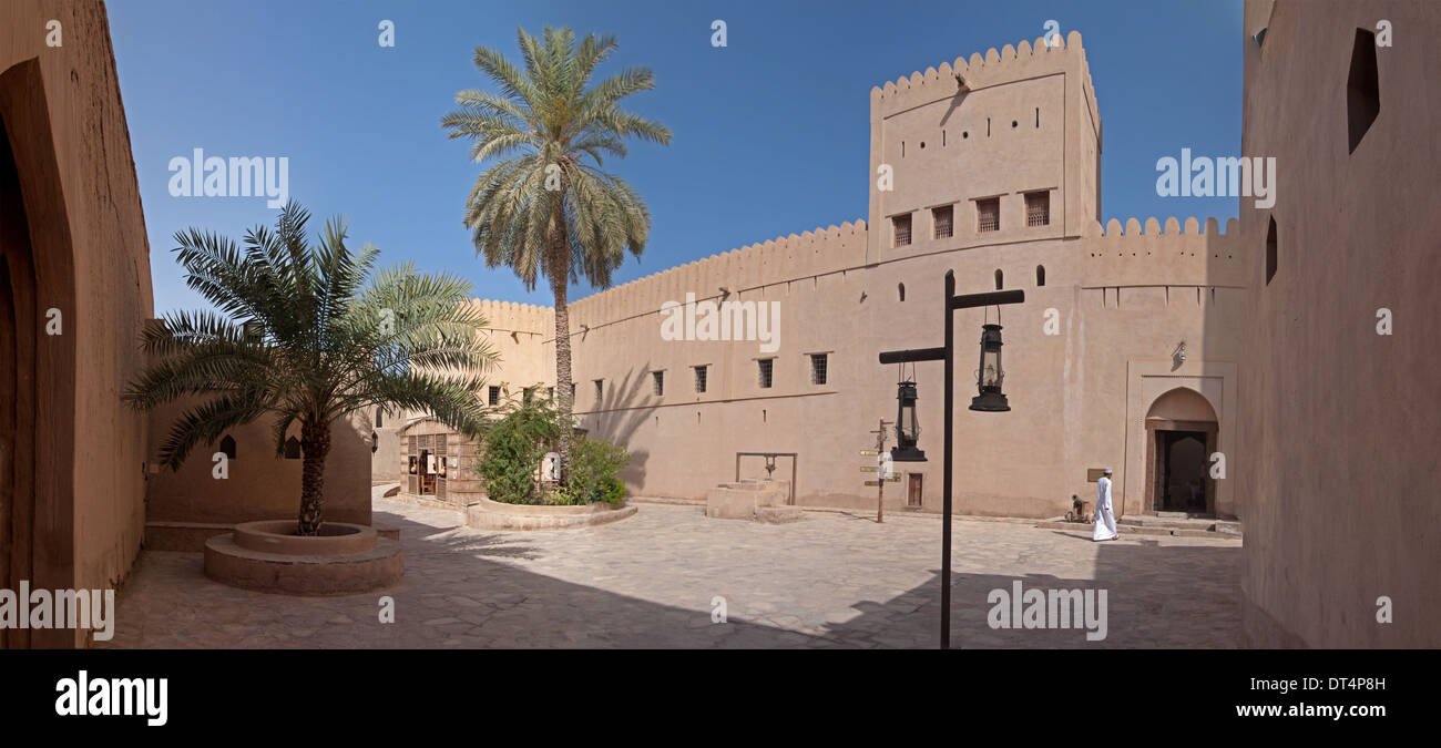 A panoramic view of the courtyard of a mud-brick fortress in Oman. - Stock Image