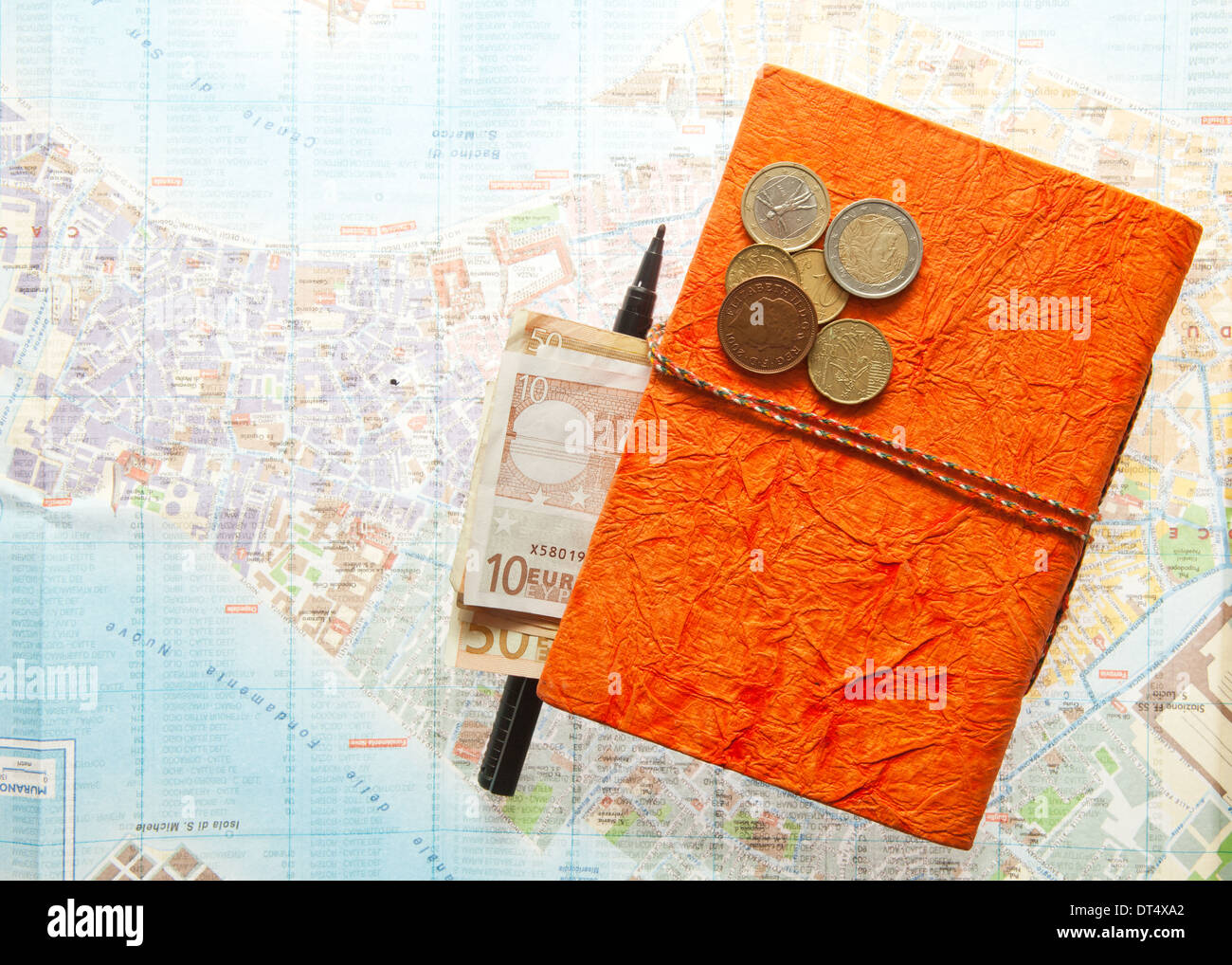 Travel Arrangement of Euro money, Map and notepad diary - Journal Stock Photo