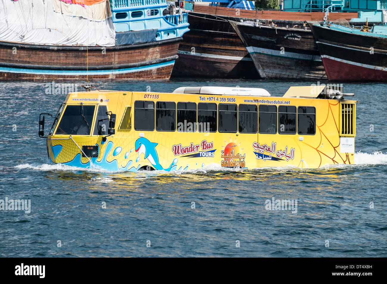 Wonder Bus tourist water tour bus on The Creek river in Dubai United Arab Emirates UAE - Stock Image
