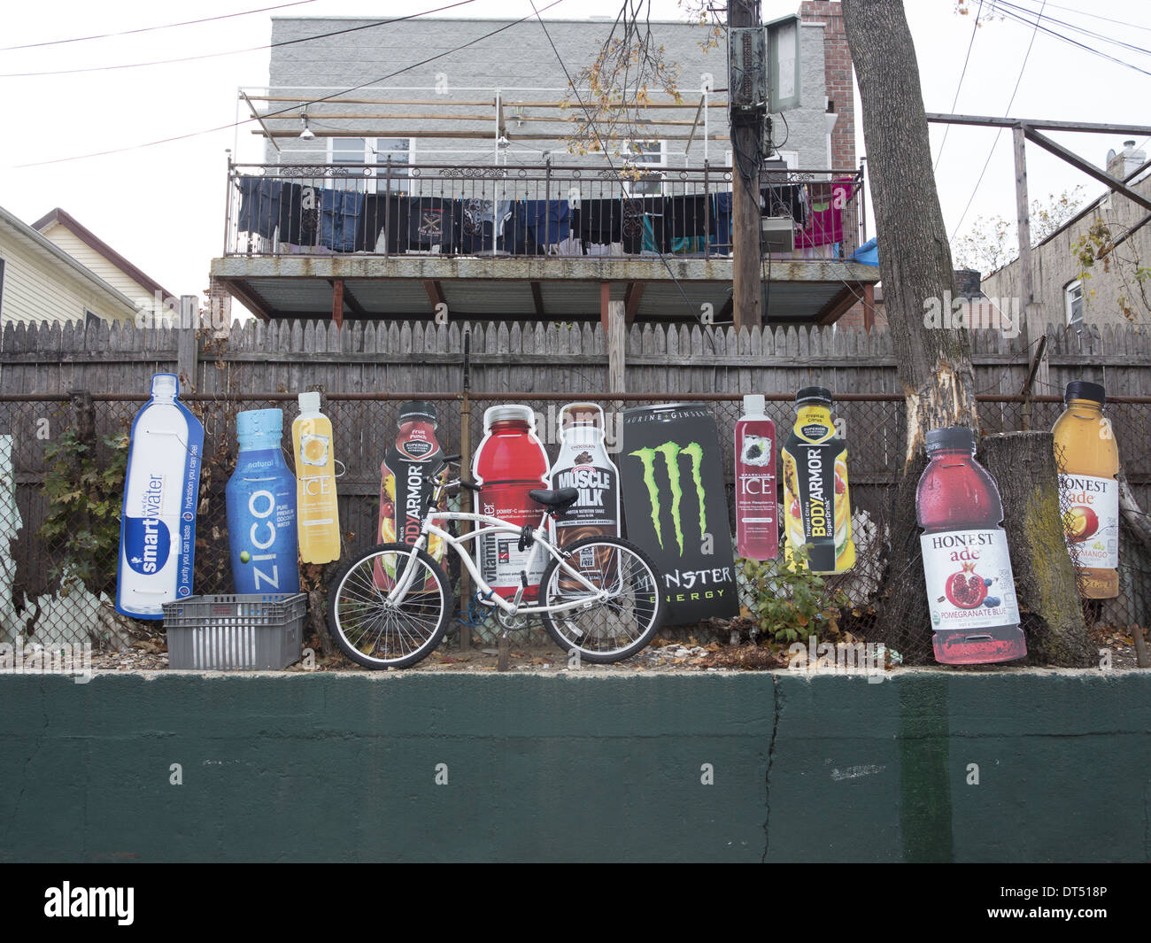 Product cutouts in the parking lot of a neighborhood market in Brooklyn, New York. - Stock Image
