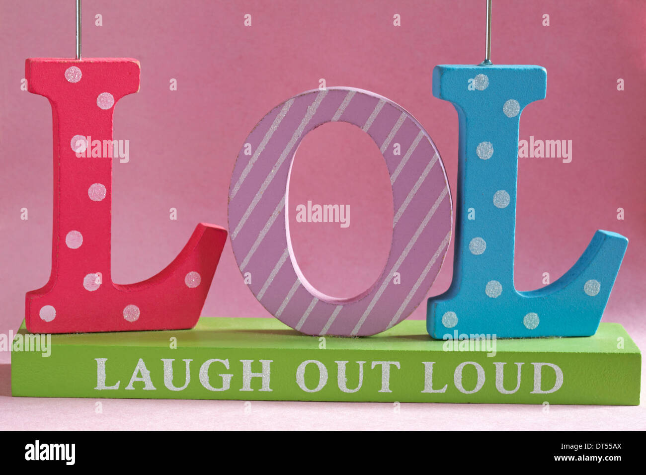 LOL Laugh Out Loud Decorative Letters Set Against Pink Background