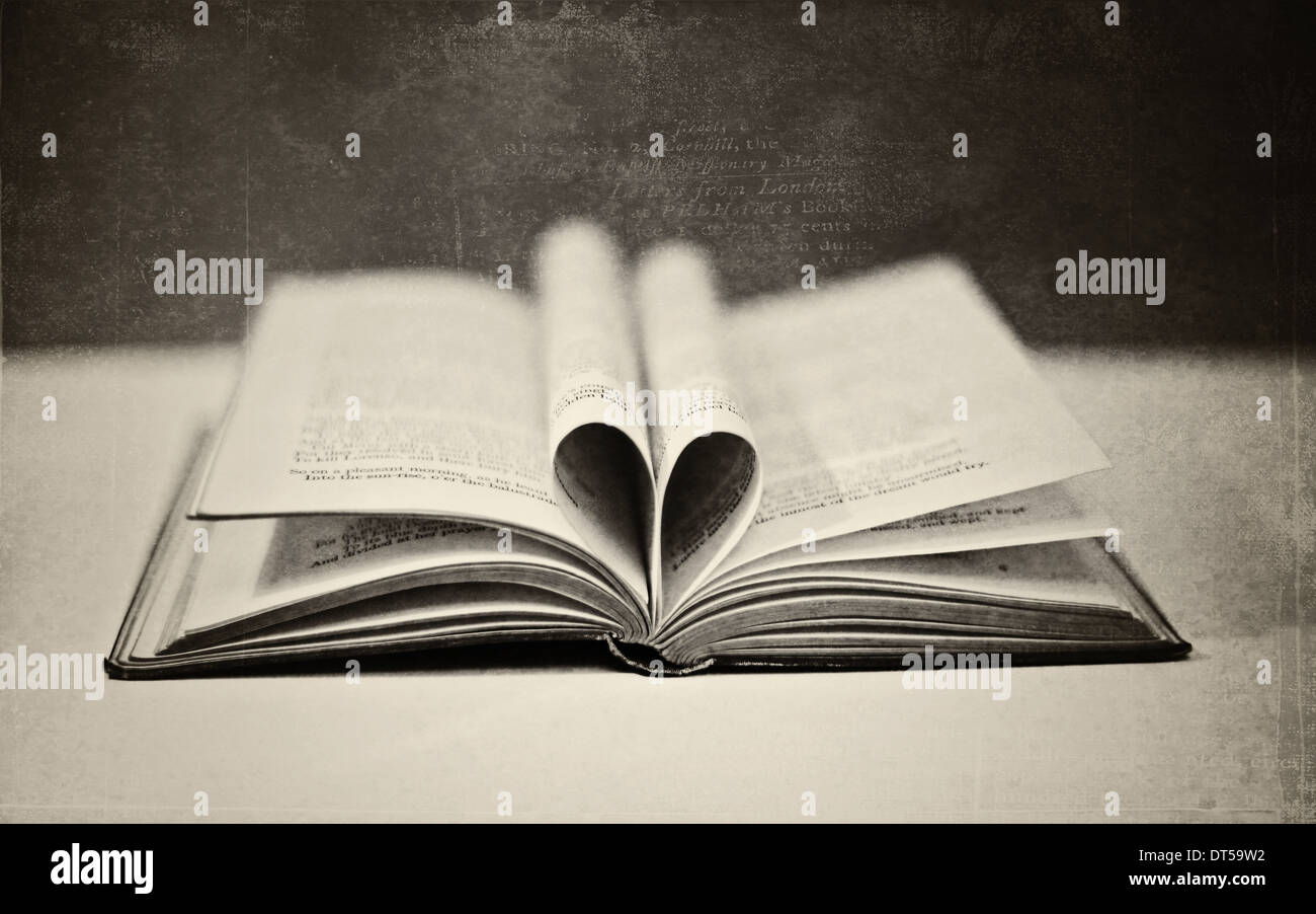 Book with heart shape pages b/w - Stock Image