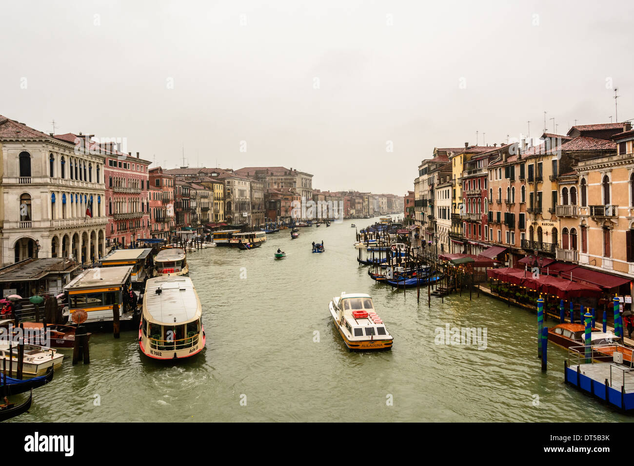 Venice, Italy. View from Rialto Bridge over the Grand Canal and the Rialto waterbus station at an overcast rainy Stock Photo