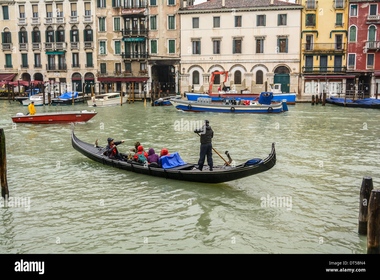 Winter in Venice, Italy. Gondola and boat traffic on the Grand Canal, Canal Grande. Stock Photo