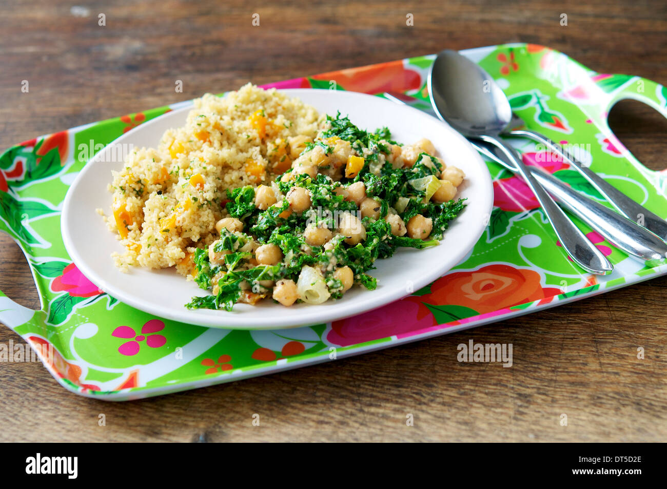 A hearty and filling meal with kale, cashew and chickpeas, served with confetti couscous. - Stock Image