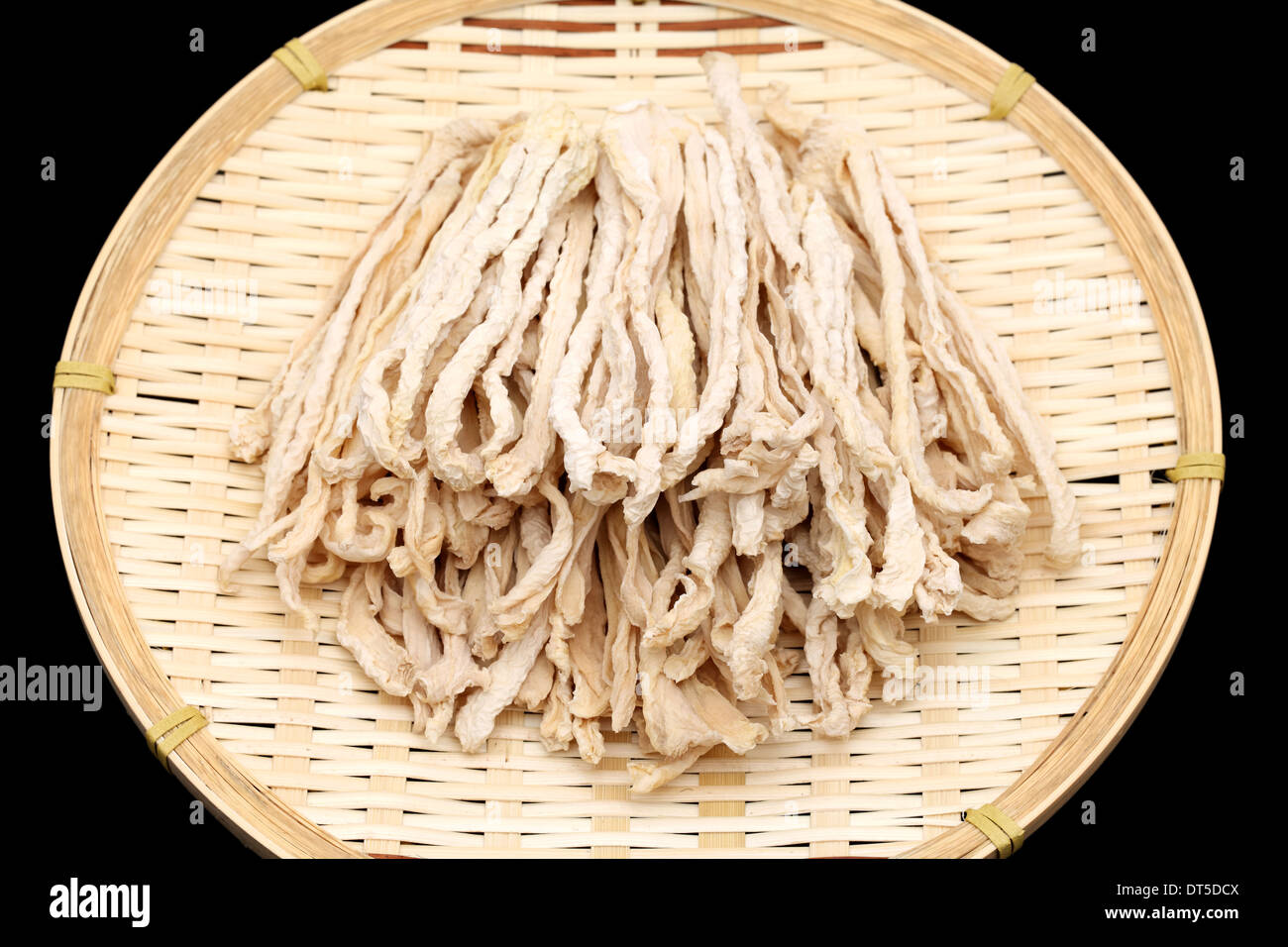 dried radish slice on bamboo basket, japanese food ingredient - Stock Image