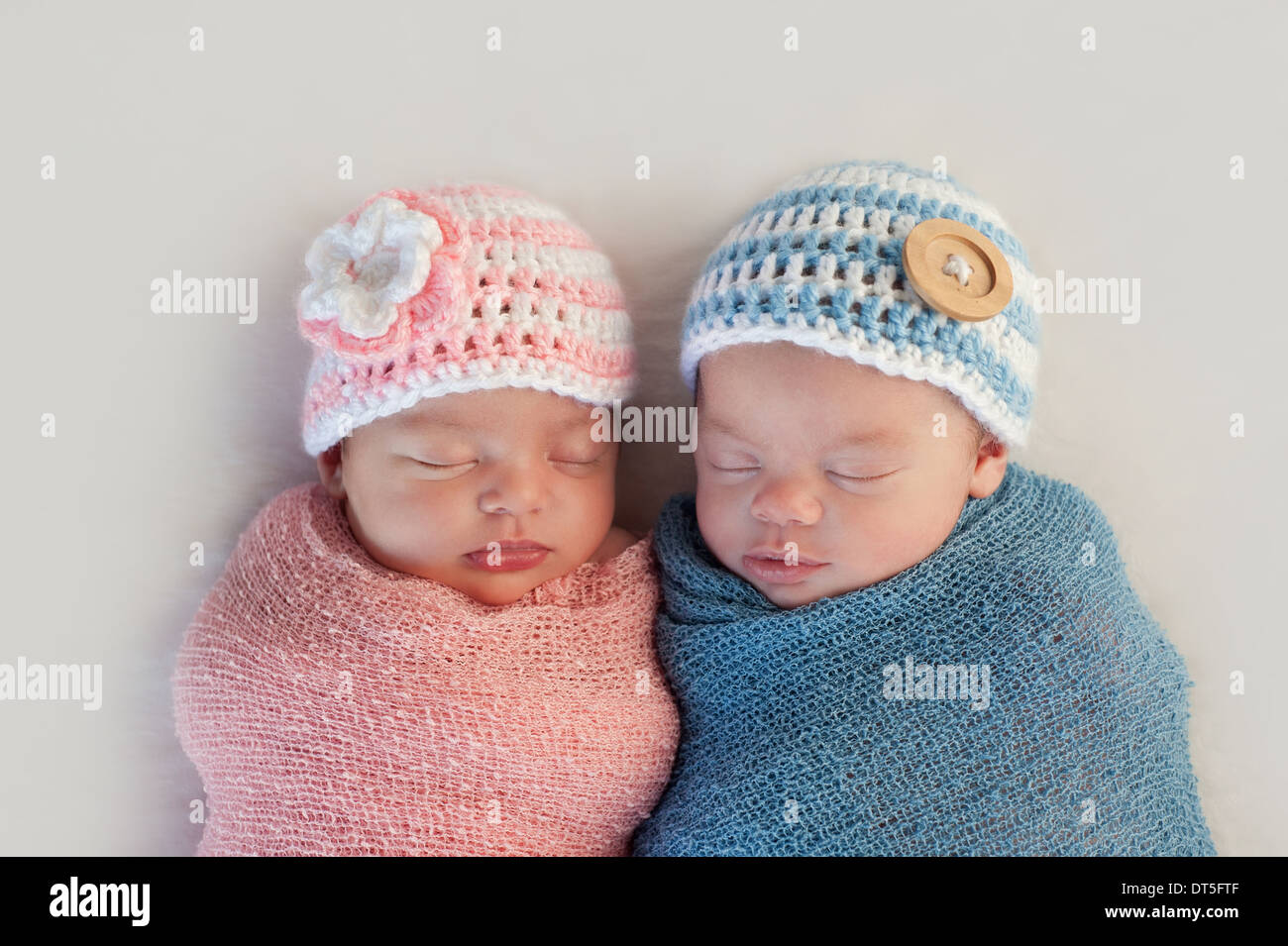 Boy and girl fraternal twin newborn babies - Stock Image