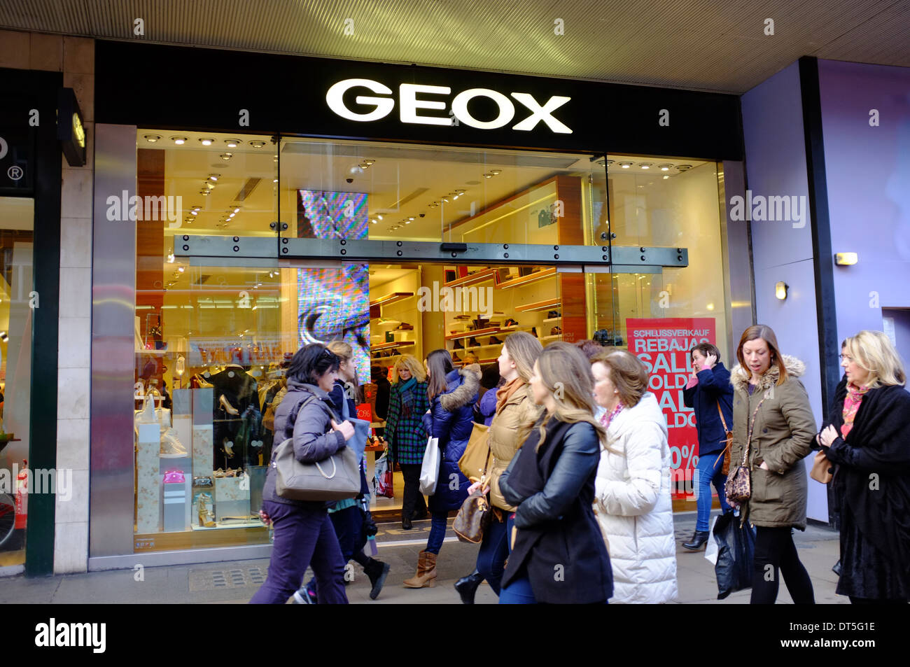 7033f2243d9 GEOX store with crowds of shoppers, Oxford Street, London - Stock Image