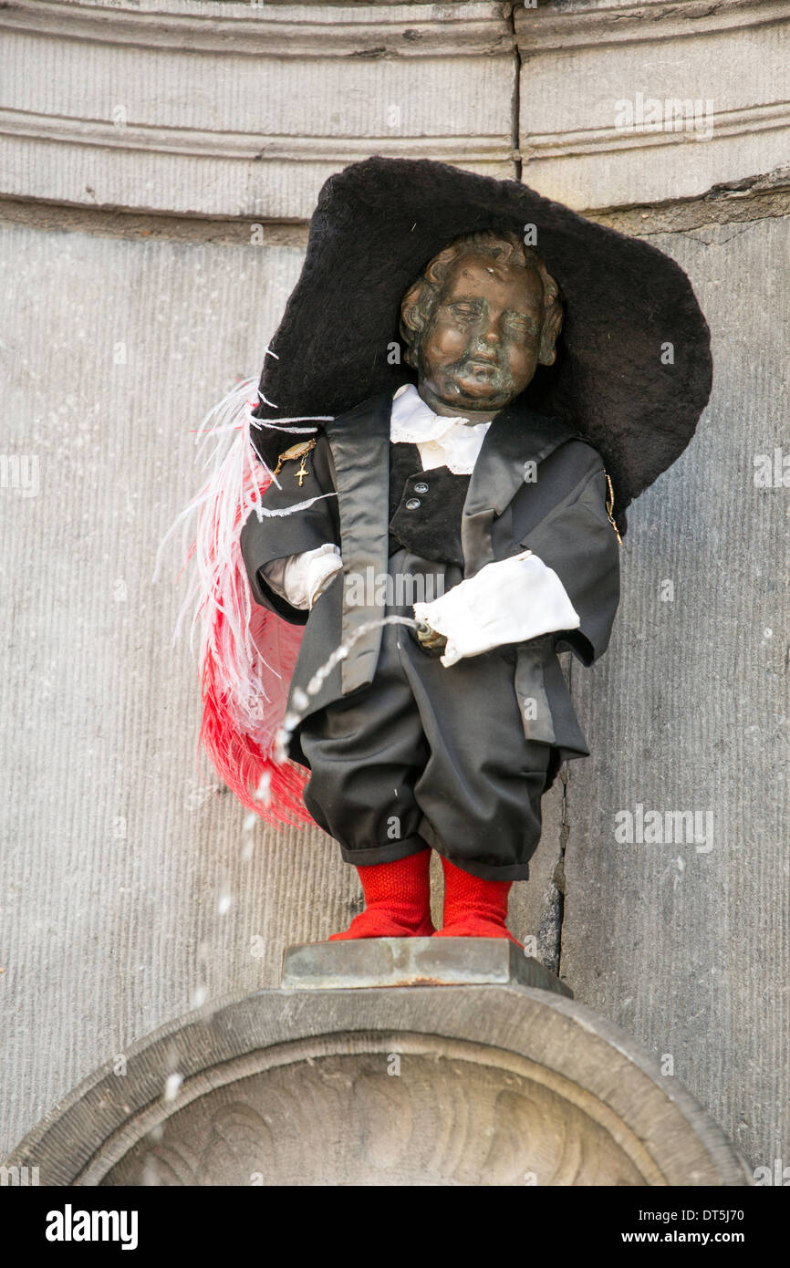 The iconic Manneken Pis statue in Brussels dressed in the costume of the Crossbowmen of Notre Dame Au Sablon. - Stock Image