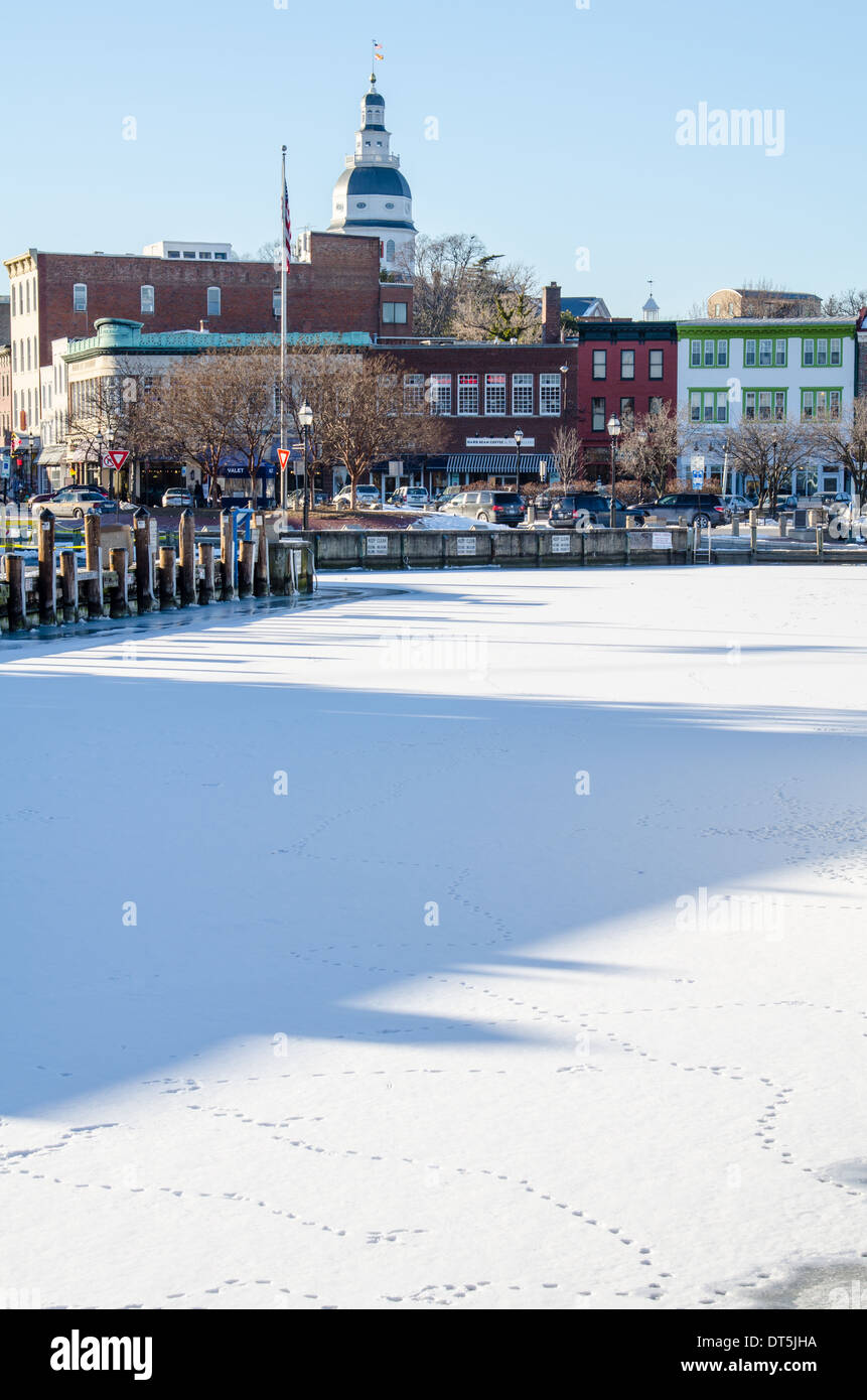 The Annapolis State House seen behind frozen dock front in winter Stock Photo