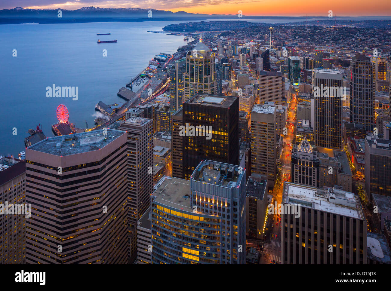 Seattle downtown with Elliot Bay and distant Olympic mountain range seen from above - Stock Image