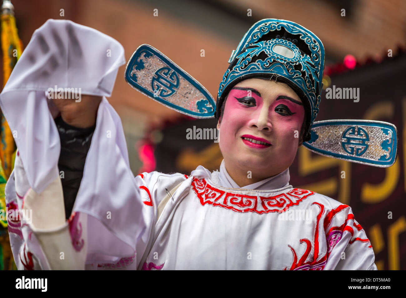 Chinese man wearing makeup parades at the Lunar New Year Festival in Chinatown. - Stock Image