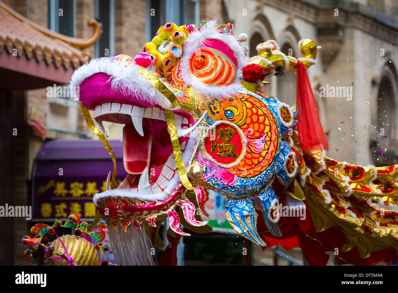 Traditional Chinese Dragon parades at the Lunar New Year Festival in Chinatown. - Stock Image