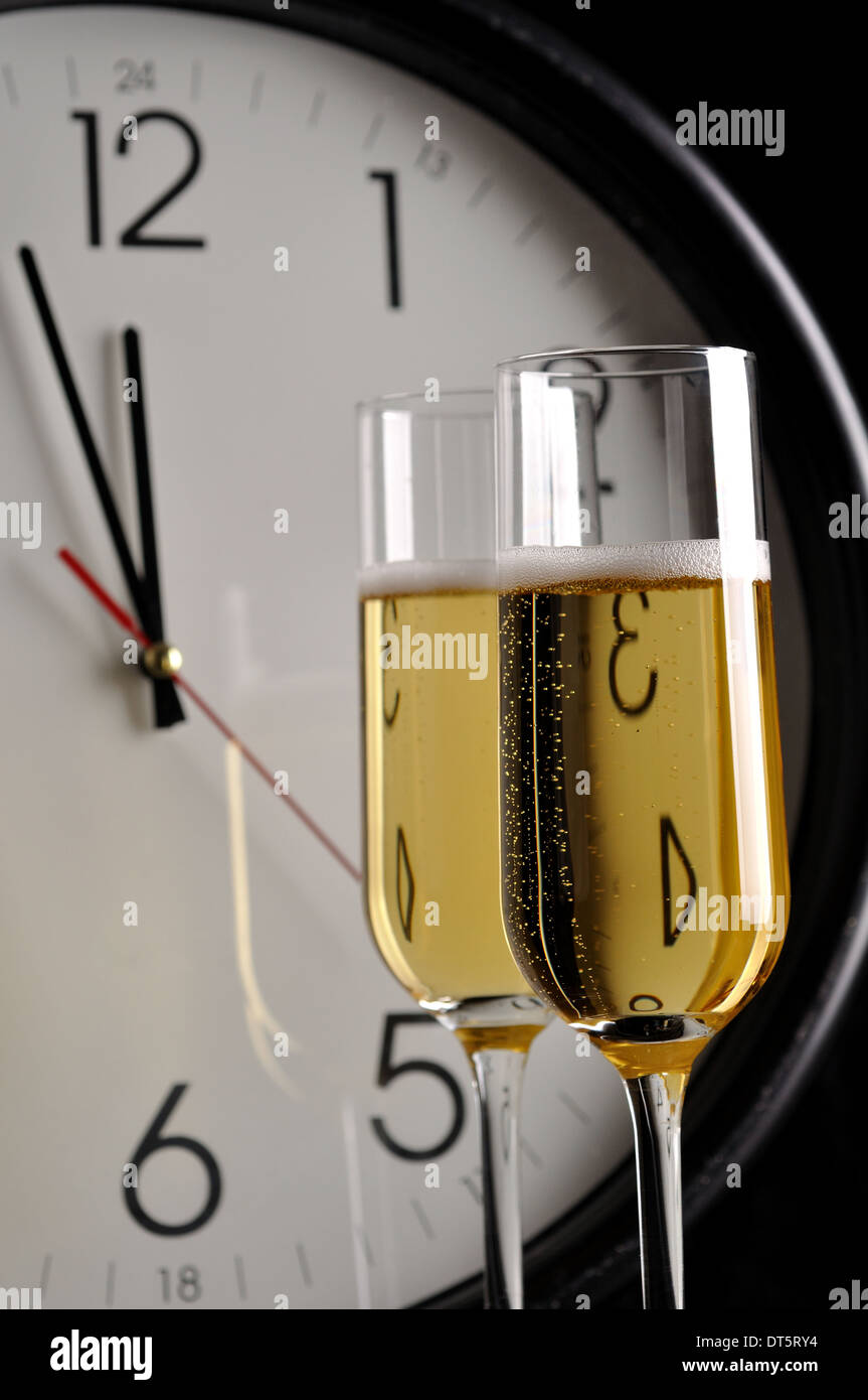 Glasses of Champagne ready to bring in the New Year - Stock Image