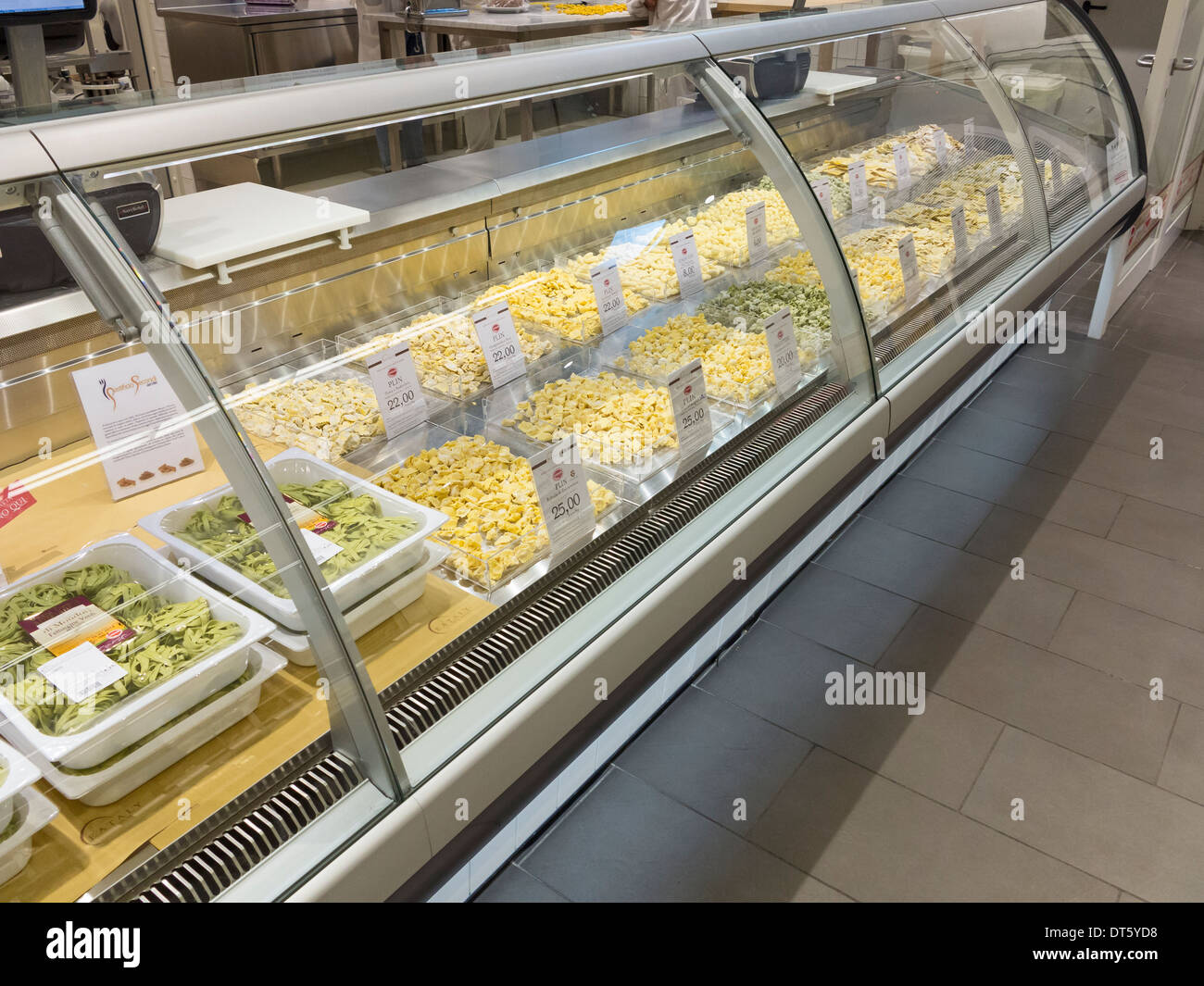 Varieties of fresh made pasta on display at an italian supermarket - Stock Image