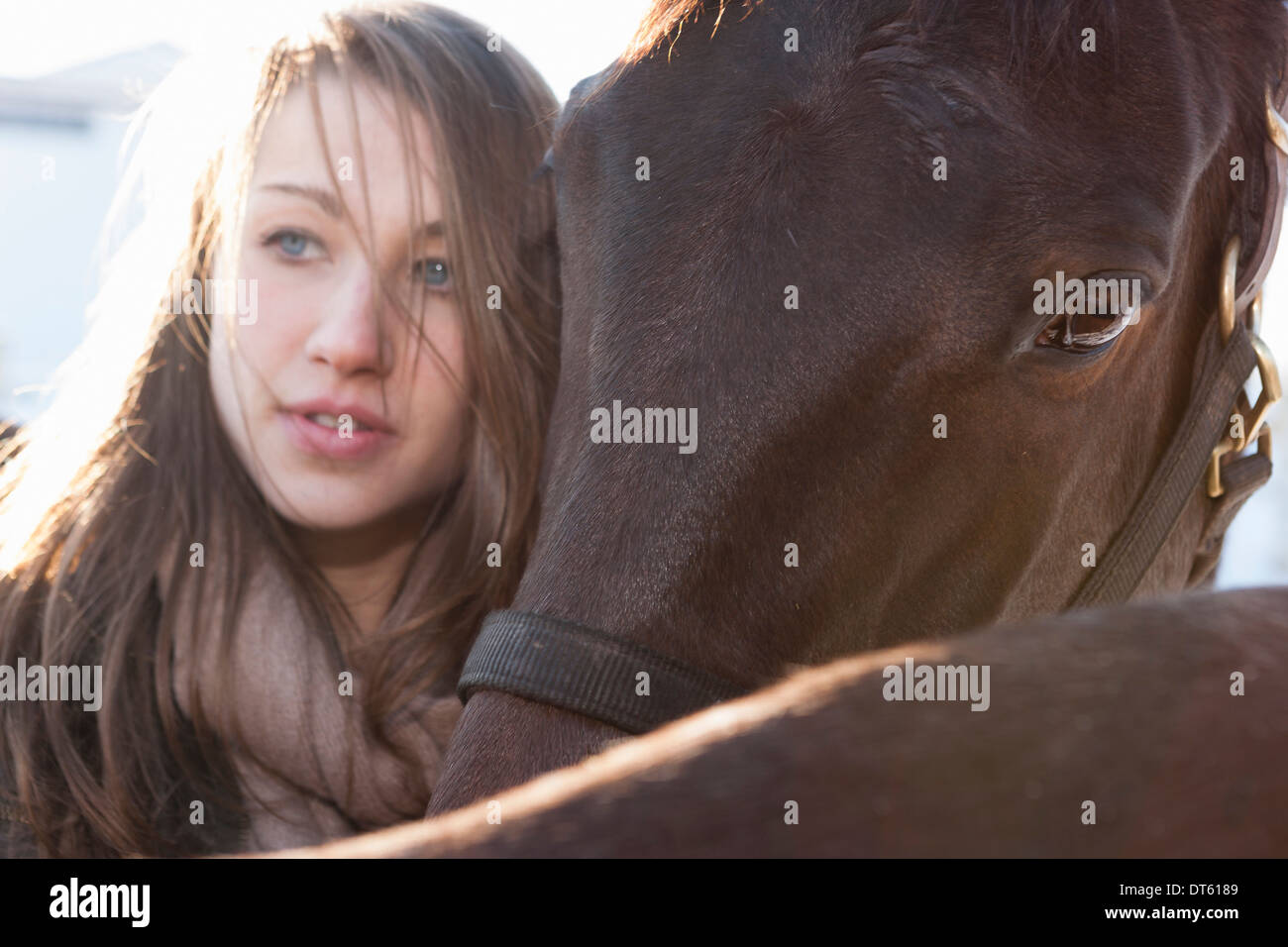 Close up of young woman with horses - Stock Image